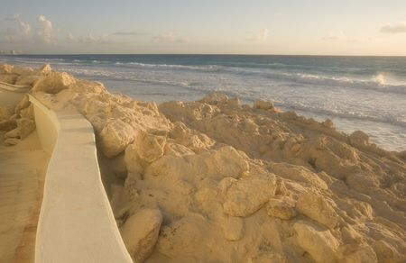 encroach: A beach showing erosion and storm damage at dawn Stock Photo