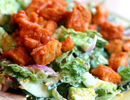 tenders: A Delicious salad with buffalo chicken tenders Stock Photo