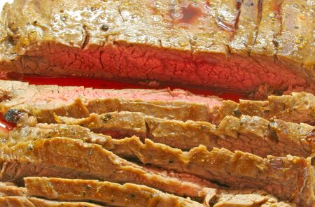 flank: A nice cut of flank steak roasted rare and sliced Stock Photo