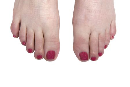 Bright red polished toenails on a white background