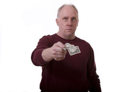 An older man in a red shirt handing across a dollar bill on a white background Stock Photo