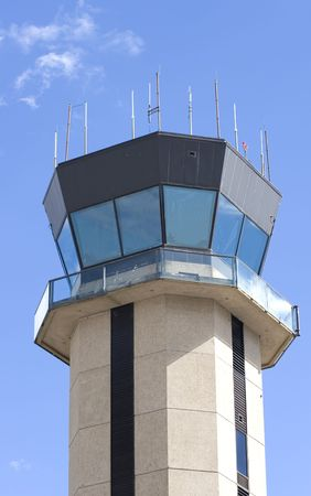 A control tower at a small regional airport against blue sky and clouds Stock Photo