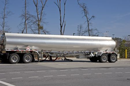 dispensing: A tanker truck dispensing fuel at a gasoline station