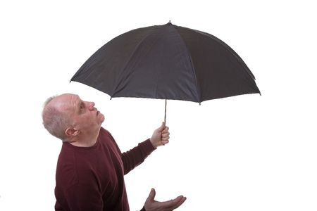 A an older man with an umbrella checking for rain on a white background Stock fotó
