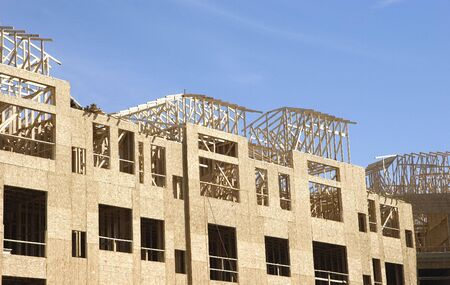 sheathing: A new apartment complex being framed with wood and plywood lumber
