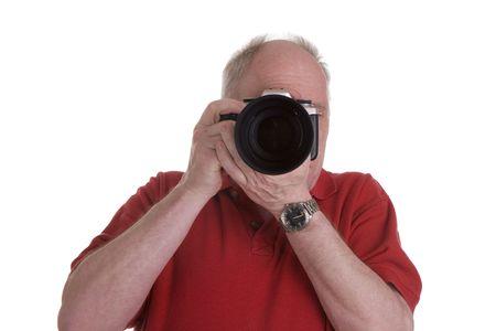 一眼レフ カメラとカメラを指しているズームレンズを持つ男