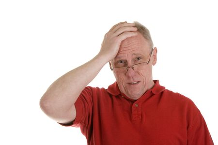 dismay: An older guy in a red shirt holding his head in dismay or with a headache