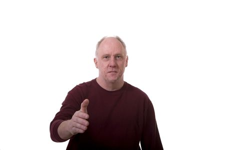 An older guy in a dark shirt shaking hands on a white background photo