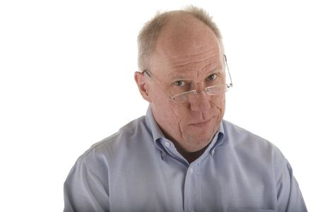 An older guy wearing a blue dress shirt giving a look of skepticism photo