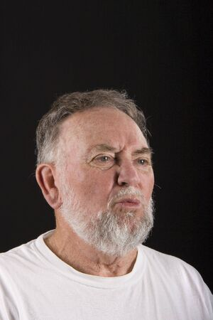 lost in thought: An older guy appearing to be lost in deep thought Stock Photo