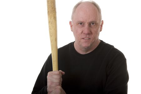 An older mean guy in a black shirt holding a baseball bat with a threatening look photo
