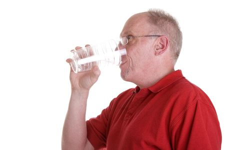 quenched: An older guy drinking water from a clear cup on a white background