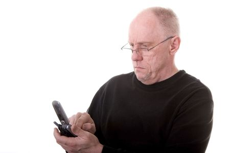 An older guy in a black shirt wearing glasses dialing a cell phone Stock fotó