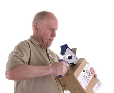 taping: An older guy taping up a box ready for shipping Stock Photo