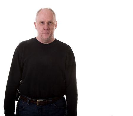 two and two thirds: A man in black from two thirds view with white copy space Stock Photo