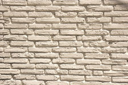 An old weathered brick wall painted white for background or texture