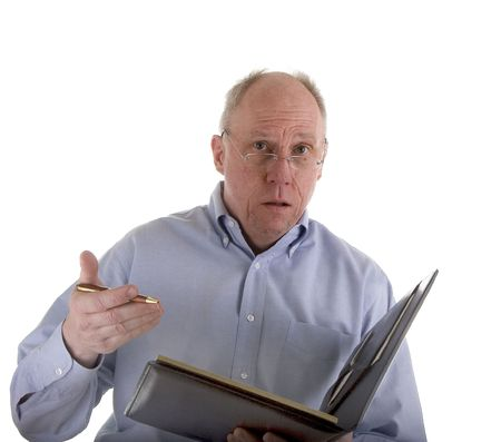 An older guy in a blue shirt explaining an estimate or problem Stock fotó