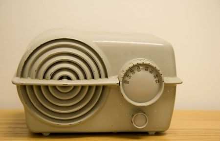 An antique plastic radio with analog dials