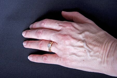 A woman's hand on black wearing a diamond ring Stock Photo - 3123930