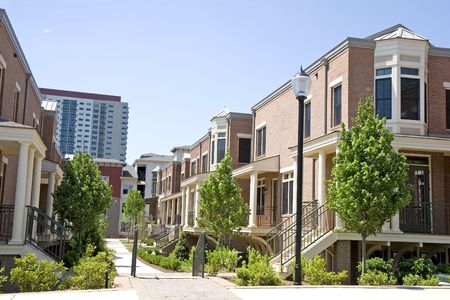 A row of new brick townhomes in an urban setting