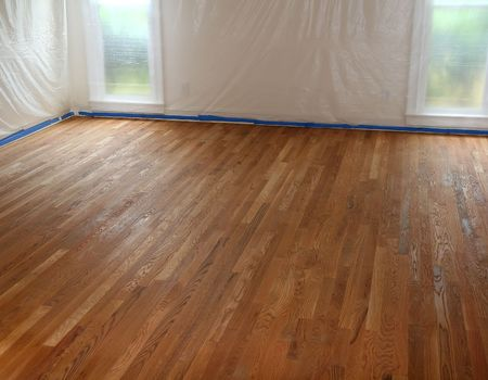 A room with hardwood floors being refinished Фото со стока