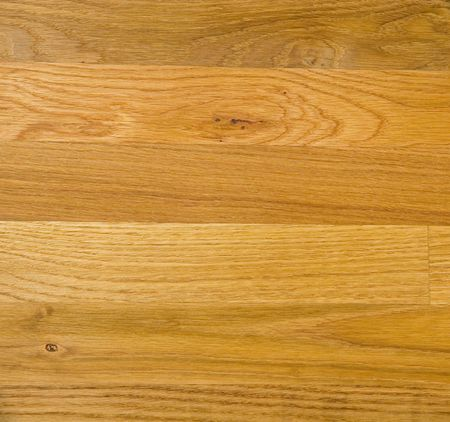 A nice new finished hardwood floor with a medium stain Stock Photo