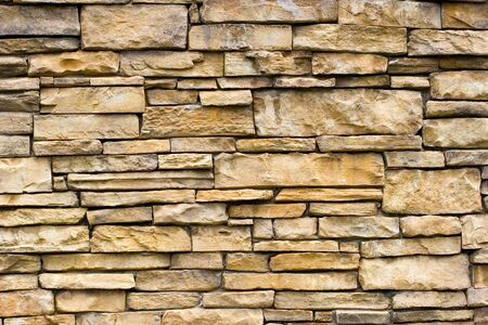 A rough stone masonry wall great for backgrounds or textures photo