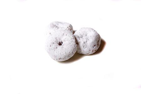 White powdered donut on a white background