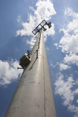 A light pole into the sky for a neighborhood baseball field