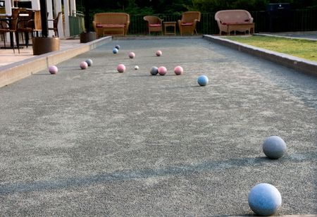 Bocce balls on a court in early morning light