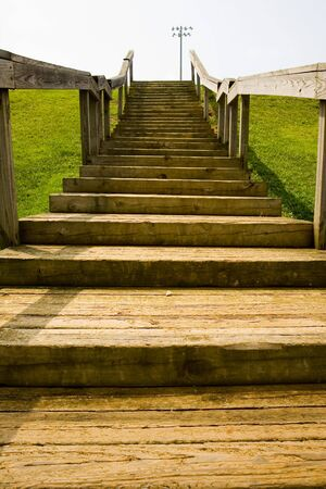 ascend: Old wooden steps up to a baseball field at a public park
