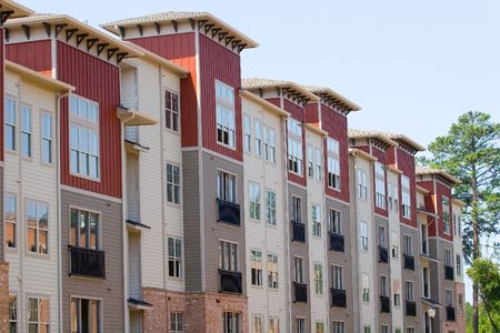 lak�hely: Rows of new brick townhomes under construction