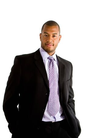 A young athletic looking businessman in a suit isolated on white Stock Photo