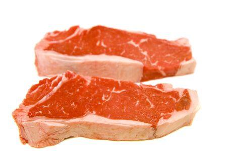 Two fresh strip steaks on a white background photo