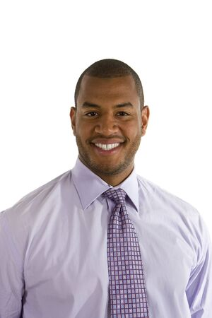 A young happy businessman in a dress shirt and tie isolated on white Stock Photo
