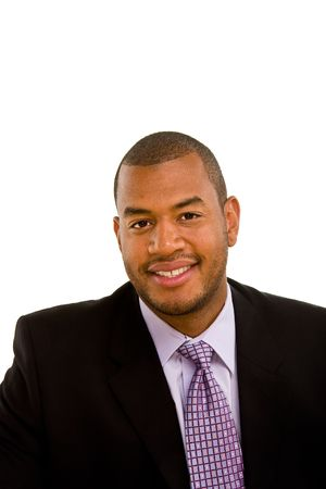A young good looking black businessman in a suit isolated on white