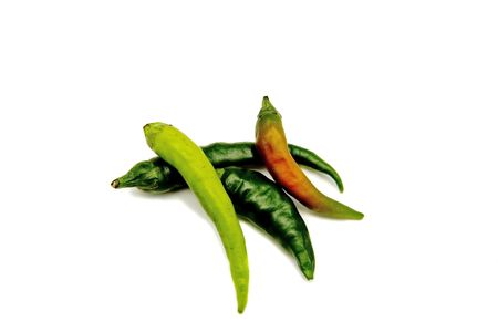 Green and red hot peppers on a white background Banco de Imagens