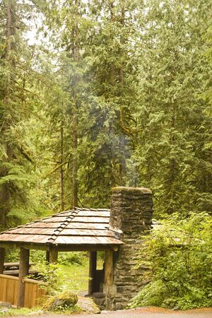 outdoor fireplace: A rustic camp site in the wilderness with a stone fireplace