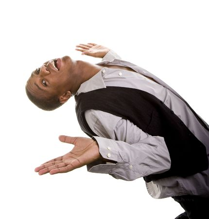 bending over: A young black man dressed casually isolated on white bending over backwards