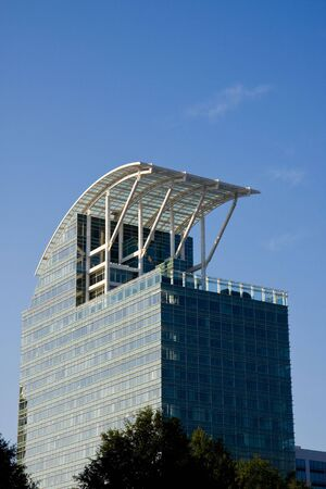 A blue glass office building with a curved roof Stock Photo - 3660898