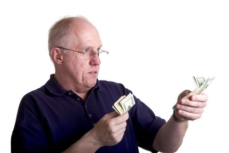 An older guy counting and handing out money Stock Photo