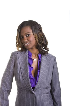 head tilted: A beautiful young black woman in business suit with her head tilted to the side