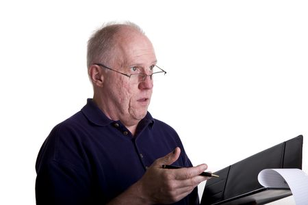An older bald guy with a notebook explaining something Imagens