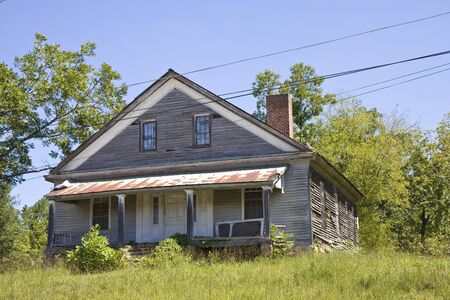 decrepit: An old abandoned house on a hill Stock Photo