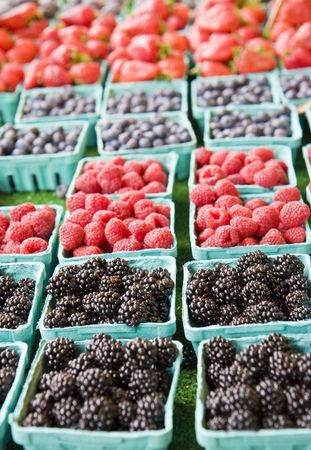 Baskets of blackberries, raspberries, blueberries, and strawberries at a local farmers market Stock Photo - 3750181