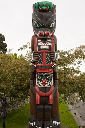A colorful totem pole in a native american park