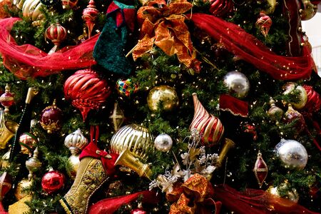 A festive holiday tree trimmed with colorful ornaments and ribbons Stock Photo - 3911807