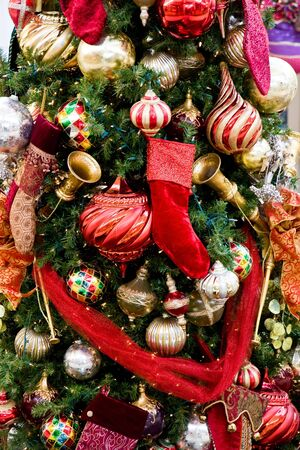 A festive holiday tree trimmed with colorful ornaments and ribbons