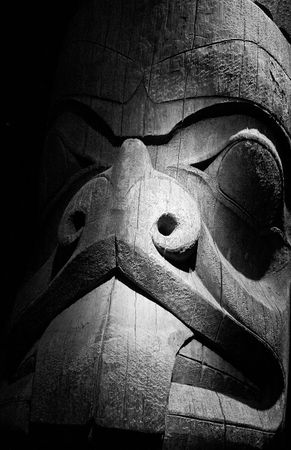 inuit: An old inuit totem carved from wood in black and white Stock Photo