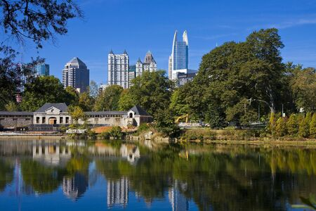 A skyline of Atlanta reflected in the blue water o fa city lake